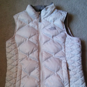 The Northface girls large 14/16 white vest.